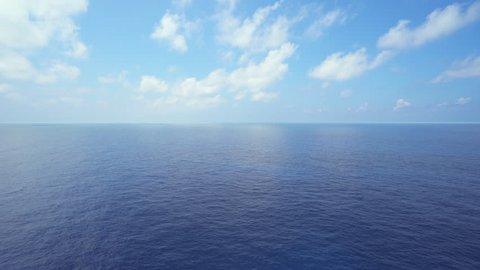 Aerial shot of open ocean. Flight over of open sea.
