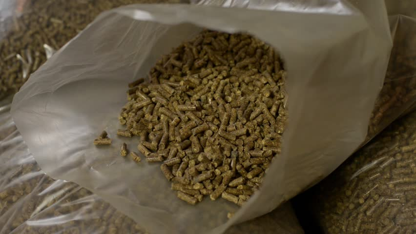 Pellet in bags ready for use. Close up shot of pellet agricultural oraganic and biological fuel.