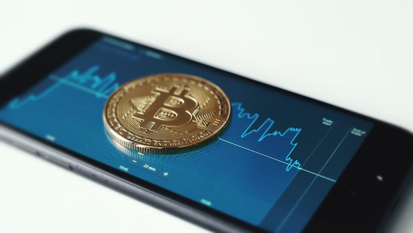 Btc bitcoin with stock market on smartphone | Shutterstock HD Video #1012558205