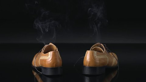 A pair of dress shoes steaming after a hot day of wear. Can also be used to infer someone has disappeared or vanished from boots.