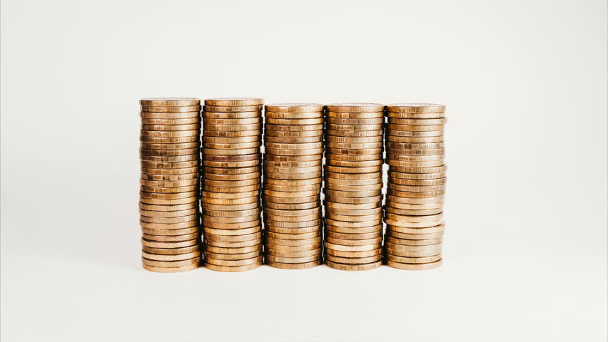 Stop motion rising stack of gold coins, rising investment and increasing profits on a white isolated background   Shutterstock HD Video #1012569905