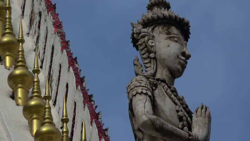 Details of Buddhist Thai Temple. Amazing roof tops with detailed art, statues, Buddhas, steeples. Traditional  temple in Thailand capital Bangkok. early morning light. Art and colorful architecture