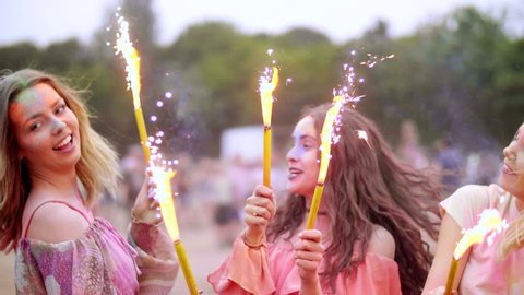 Friends with sparklers celebrating the holi festival