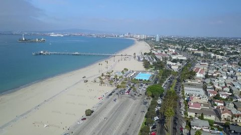 Sideways pan of the Belmont Pier in Long Beach California. Including the Belmont Pool, used in the 1984 Olympics, downtown Long Beach skyline and Palos Verdes Peninsula in the background.
