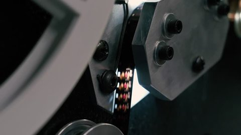 Close up of super-8mm silent movie film being scanned in a telecine machine