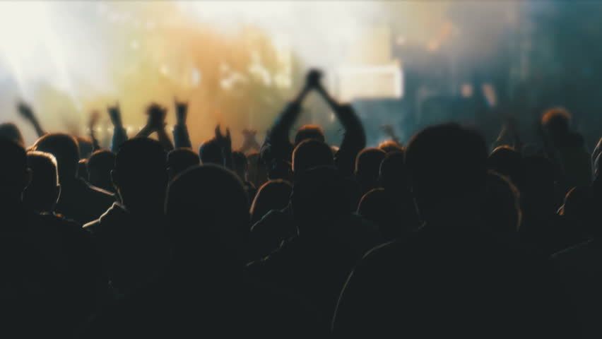 Concert Crowd at Music Festival. Crowd people dancing Rock concert, weighed, applauds, raises his hands up and photographed, filmed concert on the phones and smartphones. Party People in Action. | Shutterstock HD Video #1012624685