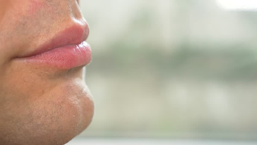 close-up. male lips in profile. sexy male lips eating a banana. 4k, slow motion.