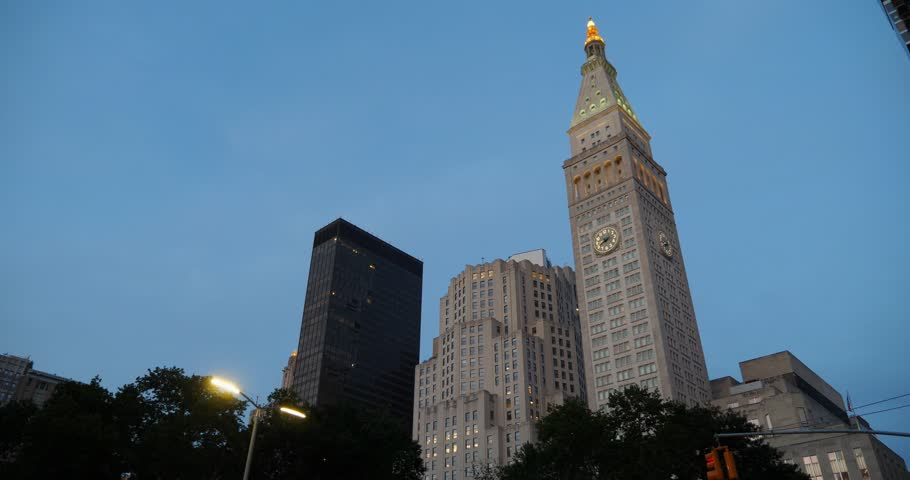 A left-to-right panning shot to the Metropolitan Life Insurance Company Tower near Madison Square Park at dusk.     Shutterstock HD Video #1012701605