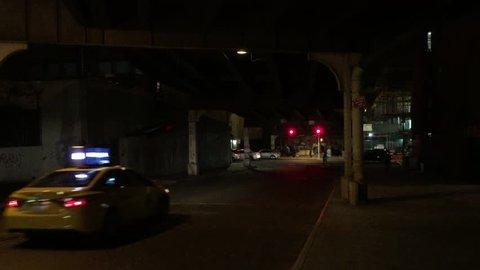 A establishing shot of shady, suspect scene under overpass bridge traffic and cars at night NX near Ed Koch Queensboro bridge on Upper East Side Manhattan