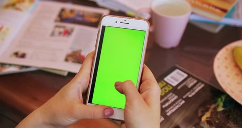Tokio, Japan - April 7, 2018. hand businesswoman using mobile cell phone with horizontal green screen at table business cup girl shopping coffee internet office telephone finger drink technology