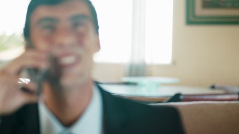 Portrait Of A Businessman Executive In A Call Celebrating Cheerful Happy