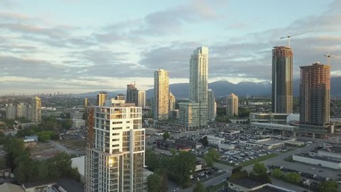Aerial view of Residential Buildings in Brentwood during a vibrant sunrise. Taken in Burnaby, British Columbia, Canada.
