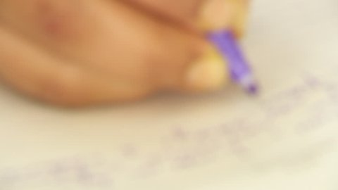 A person filling up his journal by resorting to running handwriting.