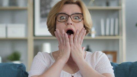 Portrait of Amazed, Surprised Old Senior Woman Wondering