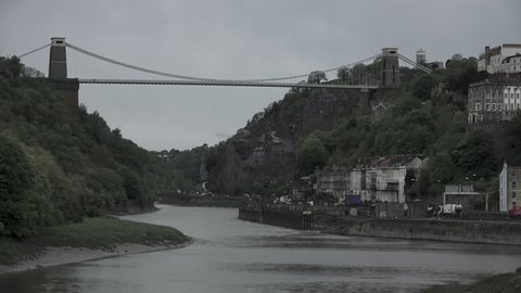 Wide shot of Clifton Suspension Bridge and Avon Gorge on a moody day