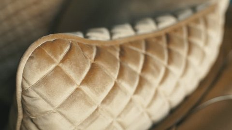 Close up leather pattern of a gold luxury sofa in the living room for background texture