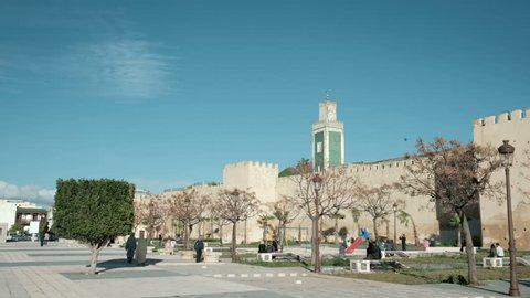 Meknes, Morocco - March 10, 2018: Camera pan right Place Lalla Aouda, old city wall and mosque minaret