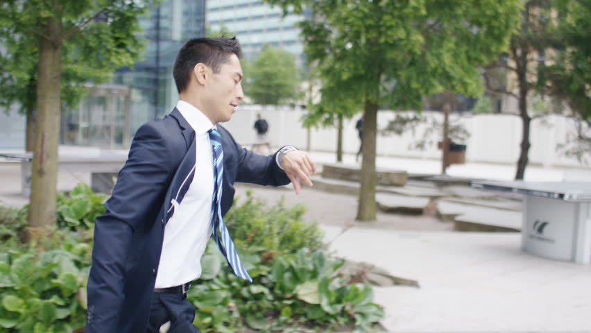 Busy man with suitcase running late for an appointment, in slow motion | Shutterstock HD Video #1012884695