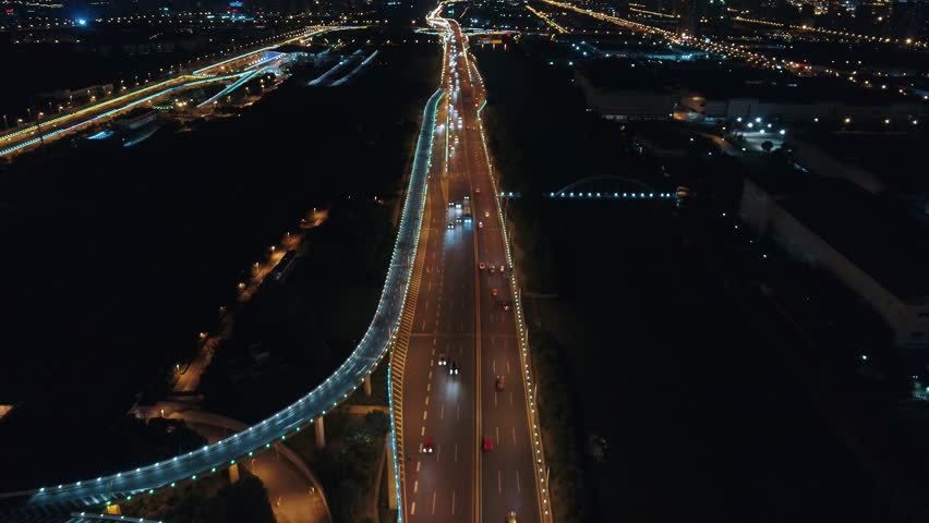 Aerial drone flight over night road traffic. Two-level road junction. Top view. 4K | Shutterstock HD Video #1012889495