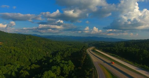 Drone floats above interstate going through smoky mountains