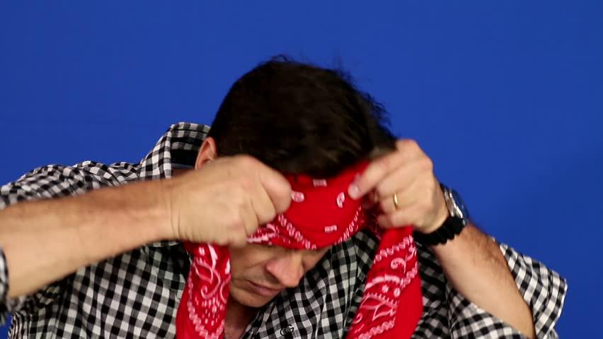 Man bandana: Friendly man putting red bandana