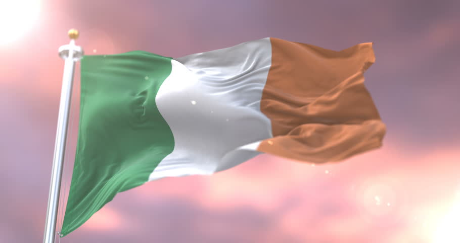 Flag of Ireland waving at wind in slow at sunset, loop | Shutterstock HD Video #1012944935