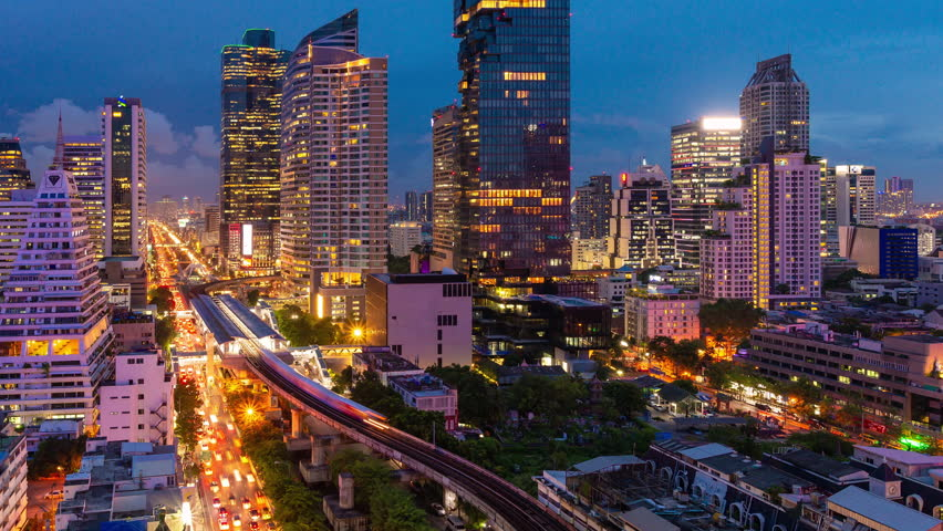 Timelapse day to night traffic during rush hour in business area at Bangkok,Thailand.Bangkok is the most populated city in Southeast Asia.