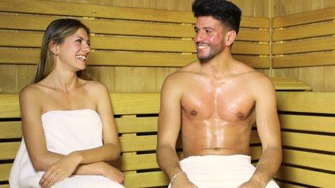Couple talking in a sauna