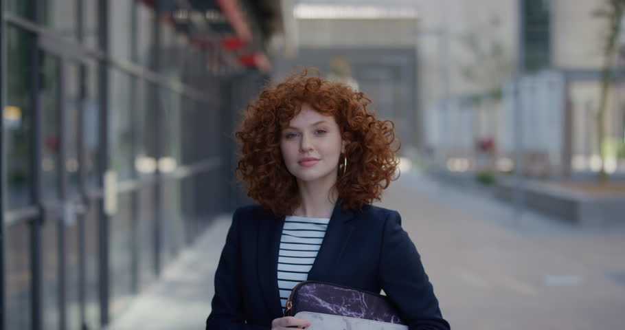 portrait young stylish business woman smiling cute red head enjoying professional urban lifestyle in city confident successful female executive slow motion attractive beauty #1013053535