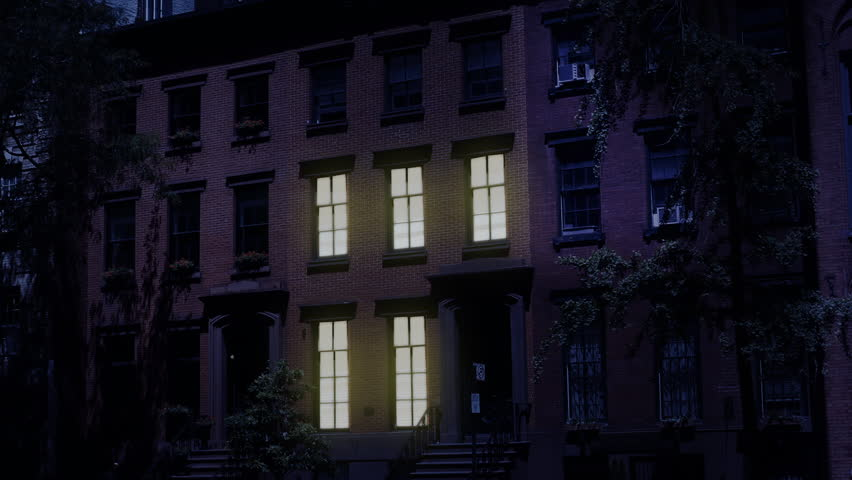 A nighttime exterior establishing shot of a typical Brooklyn brownstone residential row house. Window lights turn on and off. Simulated day-for-night treatment. Day/Night matching available. | Shutterstock HD Video #1013065115