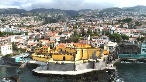 Aerial view of Sao Tiago Fort and the amphitheater-shaped city of Funchal, capital of Portugal's Autonomous Region of Madeira