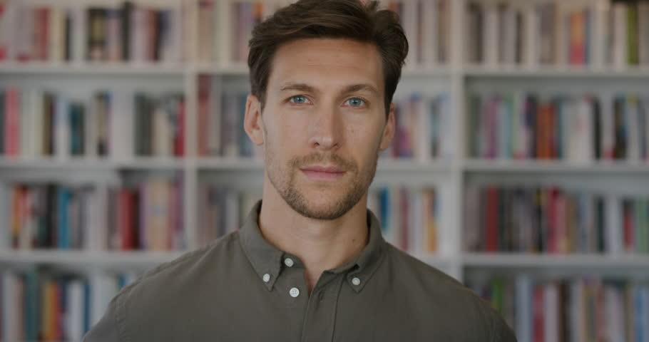 Close up portrait of attractive young businessman entrepreneur | Shutterstock HD Video #1013090375