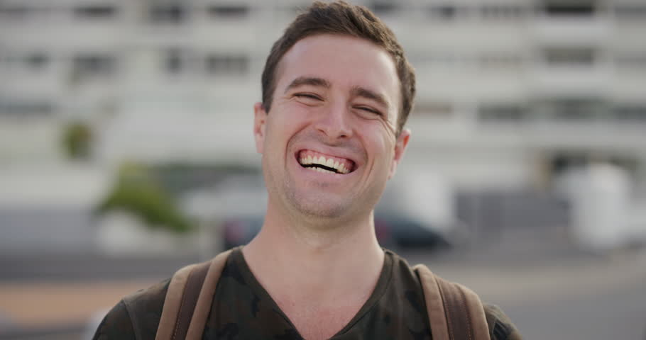99412d0c52b portrait happy young man laughing tourist enjoying successful vacation  lifestyle independent male student summer travel real people series