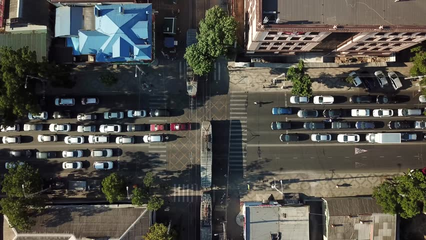 Abstract aerial drone footage of rooftops and streets in the center of Krasnodar city, Russia. Traffic congestion rush hour. | Shutterstock HD Video #1013107775