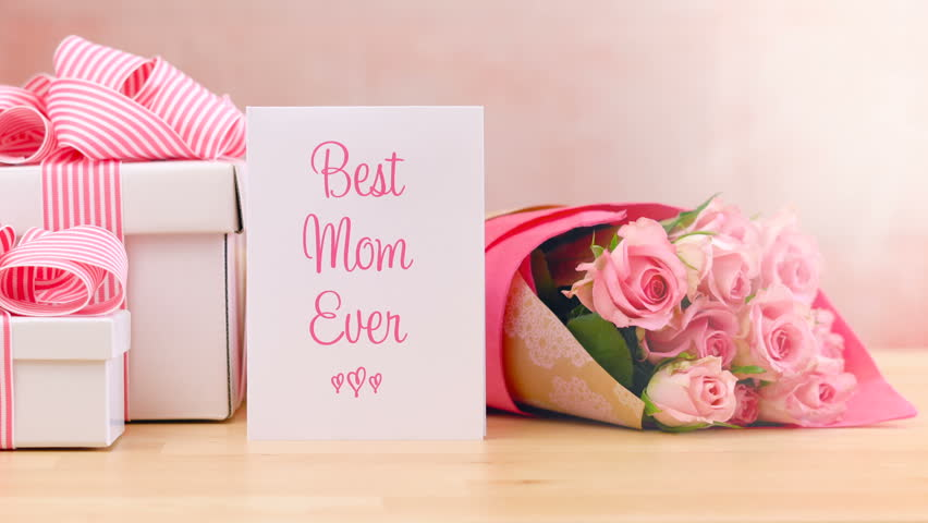 Happy Mothers Day Or Birthday Gift Pink Roses And Placing Best Mom Ever Greeting Card On Table With Lens Flare