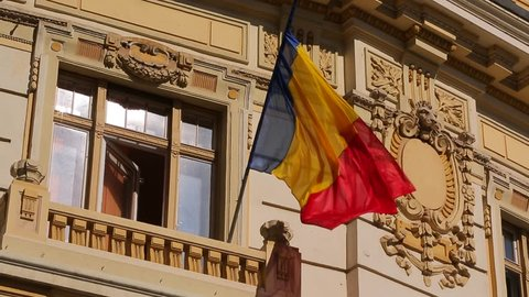 Flag hanging outside City street of eastern european country. Ancient European  Shot features European Union flag. Places to visit in Europe Romania Bukharest