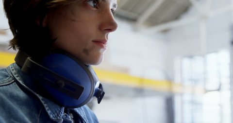 Female welder wearing protective eyewear in the workshop 4k