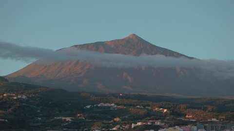 Teide volcano in Tenerfie, aerial drone view from the North coast with the small houses in the foreground. Little town with the view of the vulcan.