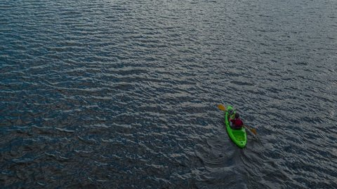 Aerial Flight Over Lonely Man Paddling Canoe At Beautiful Lake Holiday Ecology Difficulty Isolation Concept