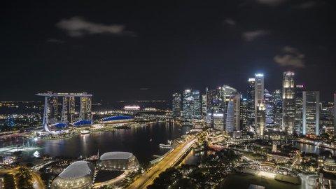 4k UHD time lapse of night scene at Marina Bay Singapore. Tilt down