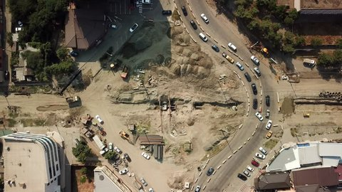 Aerial drone footage of street road  in the center of Krasnodar city, Russia. Drone view of repair the road ring.