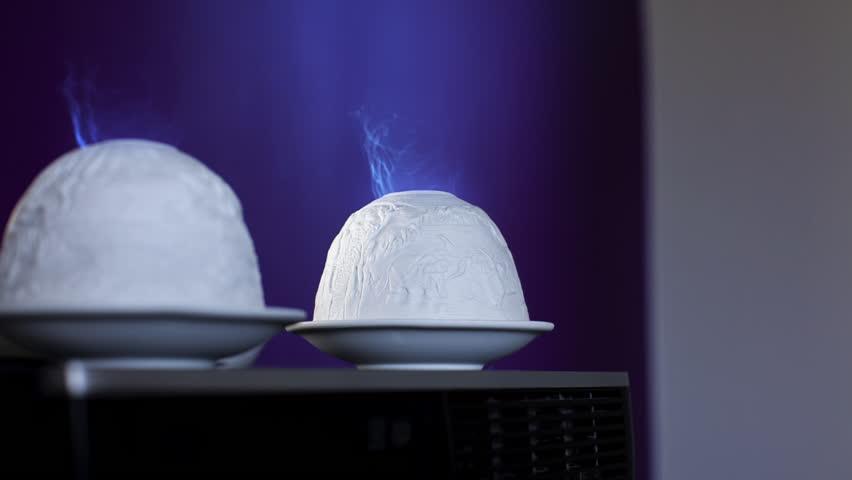 Novelty Candle Holders burning with Blue Smoke