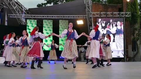 """ROMANIA, TIMISOARA - JUNE 7, 2018: Slovakian dancers in traditional costume, perform folk dance during """"International Festival of hearts"""" organized by the City hall Timisoara."""