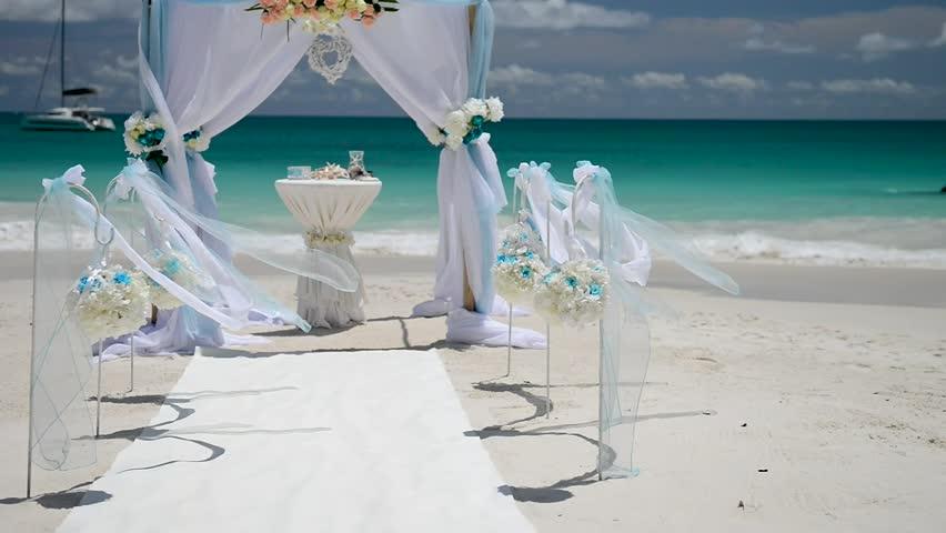 Beach wedding venue, wedding setup, arch, gazebo decorated with flowers, setup for marriage.