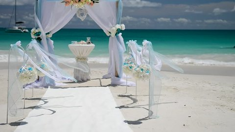 Beach wedding venue, wedding setup, arch, gazebo decorated with flowers, setup for marriage.