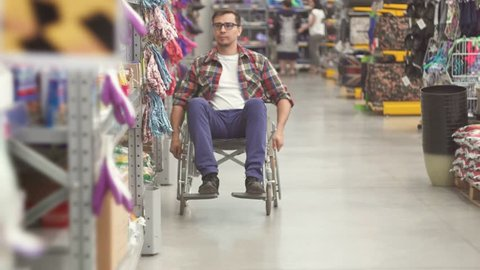 Portrait of a man with a disability wearing of a wheelchair in the Mall
