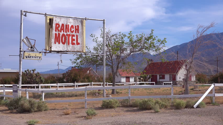 USA - CIRCA 2017 - An abandoned or rundown old Ranch motel along a rural road in America.