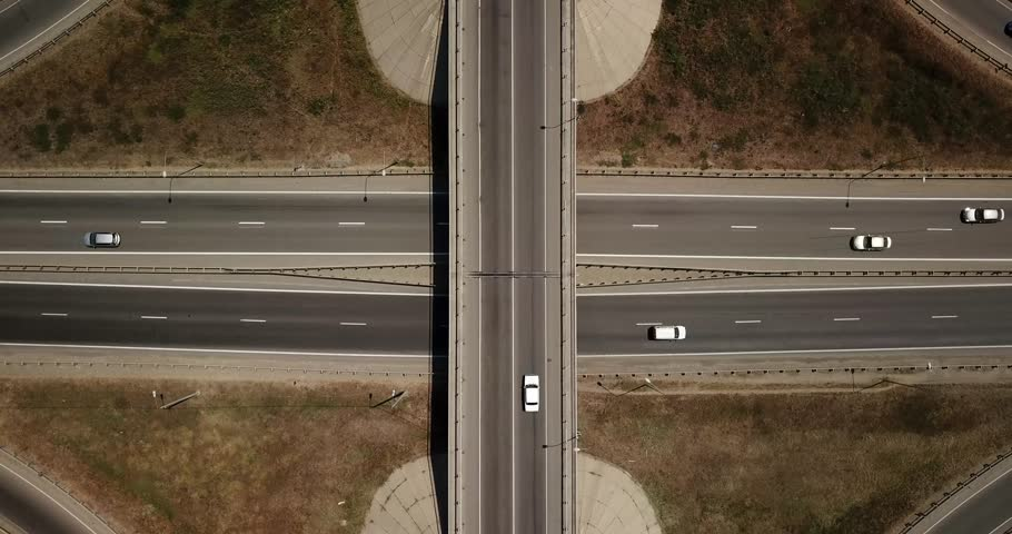 Summer aerial footage of transport junction, traffic cross road junction day view from above with circle road. Top down view of traffic jam. | Shutterstock HD Video #1013442095