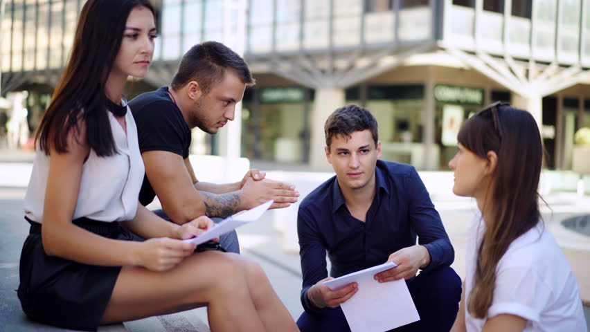 Creative business team meeting in modern working . Group of young people discussing start-up ideas, laughing.   Shutterstock HD Video #1013498675