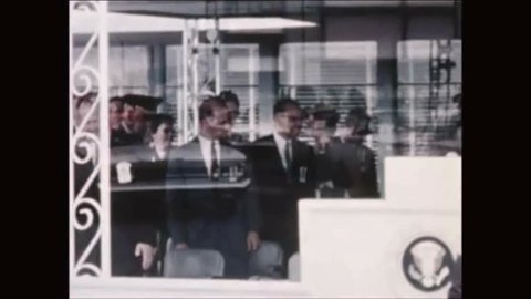CIRCA 1960s - President Eisenhower and aerospace engineer Wernher von Braun ride in a motorcade to the fabrication and assembly engineering division.